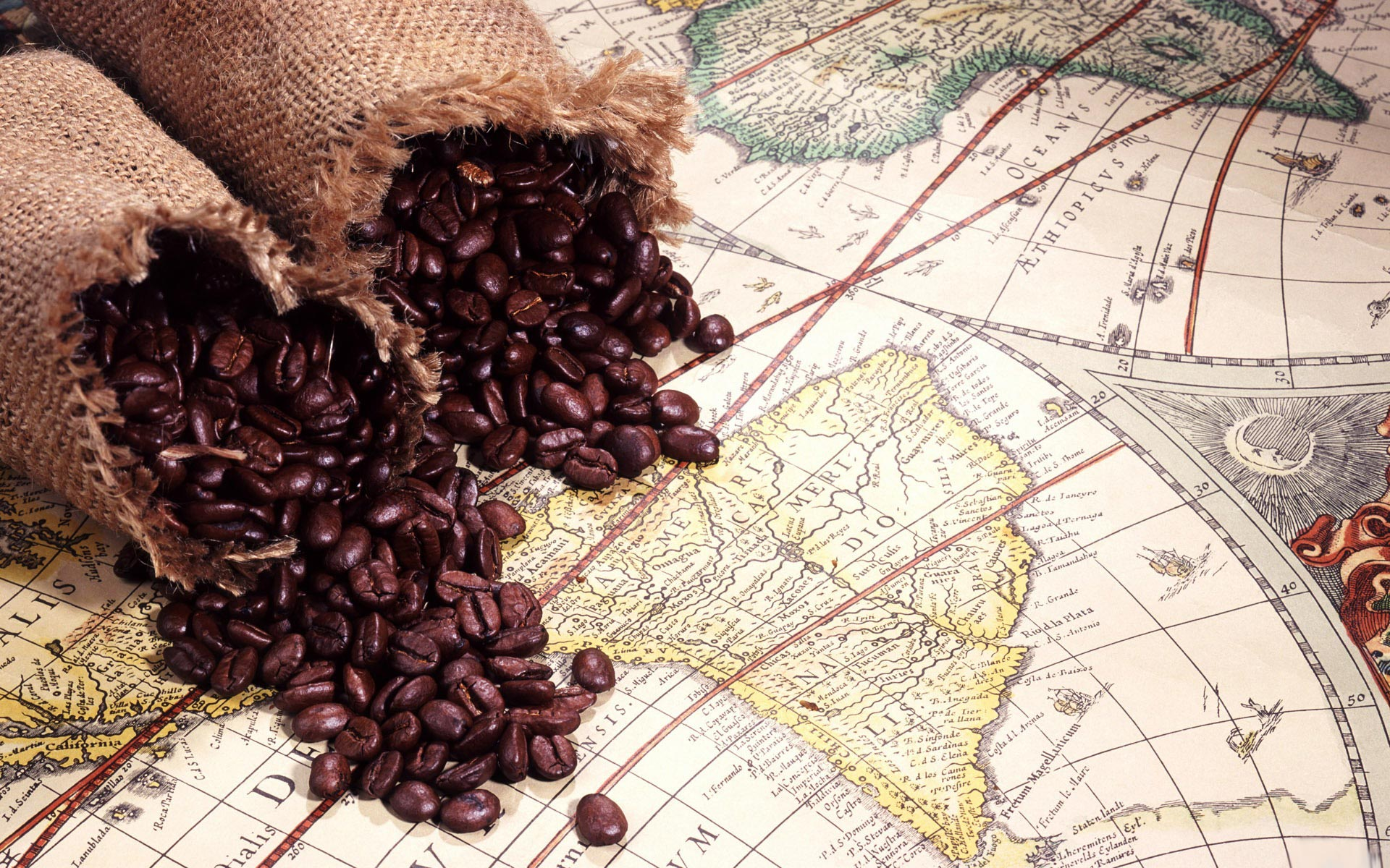 coffee-beans-on-world-map-artistic-wallpaper-1920x1200-3697